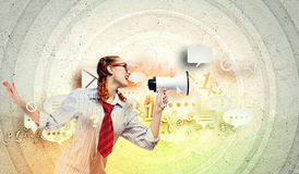 Funny looking woman with megaphone Stock Photography