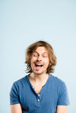 Funny man portrait real people high definition blue background Stock Photo