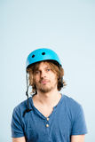 Funny man wearing cycling helmet portrait real people high defin Stock Image