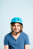 Funny man wearing cycling helmet portrait real people high defin Stock Images
