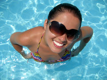 Funny looking young woman in the pool Royalty Free Stock Photo