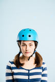 Funny woman wearing cycling helmet portrait real people high def Stock Image