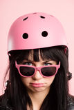 Funny woman wearing Cycling Helmet portrait pink background real Stock Photos