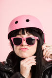 Funny woman wearing Cycling Helmet portrait pink background real Stock Photography