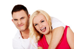 Funny love couple making stupid faces Stock Photo