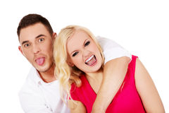 Funny love couple making stupid faces Stock Photos