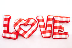 Funny love word of plush red letters on white. Background. Full plaid textile. February 14, Valentine's Day concept shot with text space. Top view. High Royalty Free Stock Photo