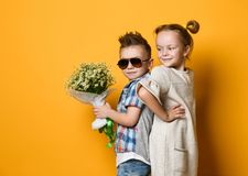 Ashionable little boy and girl in jeans and plaid shirts royalty free stock images