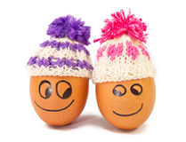 Funny lovely  eggs in winter hats Stock Image