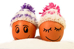 Funny lovely  eggs in winter hats and sugar like a snow Royalty Free Stock Images
