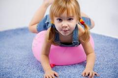 Funny lovely little girl Stock Images
