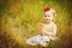 Funny lovely little girl playing in the park Royalty Free Stock Images