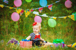 Funny lovely little girl playing in the park Royalty Free Stock Image