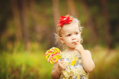 Funny lovely little girl playing in the park Royalty Free Stock Photo
