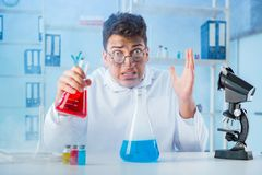 The funny mad chemist working in a laboratory. Funny mad chemist working in a laboratory Stock Photo