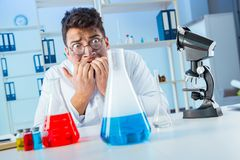 The funny mad chemist working in a laboratory. Funny mad chemist working in a laboratory Stock Photos
