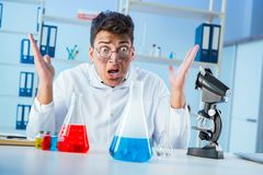 The funny mad chemist working in a laboratory. Funny mad chemist working in a laboratory Royalty Free Stock Photography