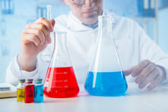 The funny mad chemist working in a laboratory. Funny mad chemist working in a laboratory Stock Images