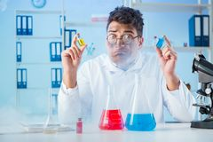 The funny mad chemist working in a laboratory. Funny mad chemist working in a laboratory Royalty Free Stock Image