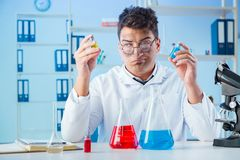 The funny mad chemist working in a laboratory. Funny mad chemist working in a laboratory Royalty Free Stock Photos