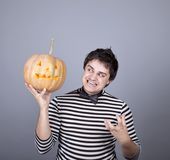 Funny mad men kepping pumpkin. Stock Image