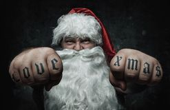 Funny mad Santa Claus showing tattoos royalty free stock photos