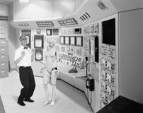 Funny Mad Scientist, Love Robot. A funny retro vintage mad scientist invents a female woman love robot for romance and dating. The man can`t wait to start royalty free stock images