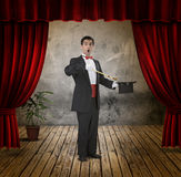 Funny magician. A funny magician on stage Stock Images
