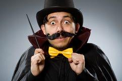 Funny magician man with wand Stock Photos