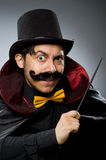 Funny magician man with wand Stock Images