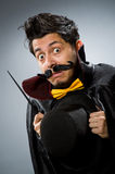 Funny magician man with wand Stock Photo