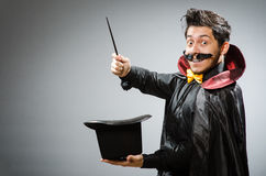 Funny magician man with wand Royalty Free Stock Image