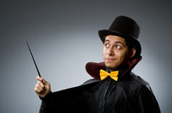 Funny magician man with wand Royalty Free Stock Photos