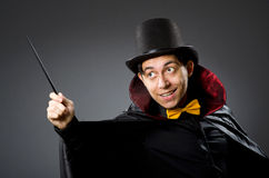 Funny magician man with wand Stock Image