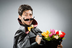 Funny magician man with wand Stock Photography