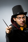 Funny magician man with wand and hat Stock Photo