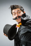Funny magician man with wand and hat Royalty Free Stock Image