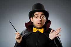 Funny magician man with wand and hat Stock Images