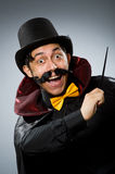 Funny magician man with wand and hat Royalty Free Stock Images