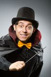 Funny magician man with wand and hat Royalty Free Stock Photography