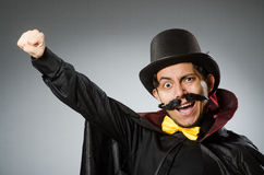 The funny magician man wearing tophat Stock Photos
