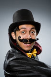 The funny magician man wearing tophat Royalty Free Stock Image