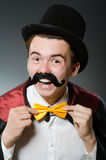 The funny magician man wearing tophat Stock Images