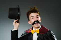 The funny magician man wearing tophat Stock Image