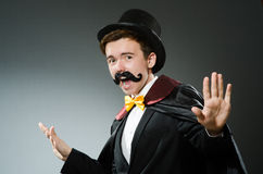 The funny magician man wearing tophat Royalty Free Stock Photography