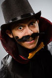 The funny magician man wearing tophat Stock Photography