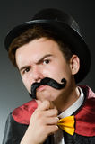 Funny magician man wearing tophat Stock Photography