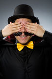 Funny magician man wearing tophat Royalty Free Stock Photography
