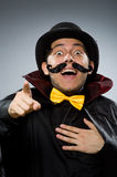The funny magician man wearing tophat Stock Photo