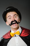 Funny magician with wand Stock Photos
